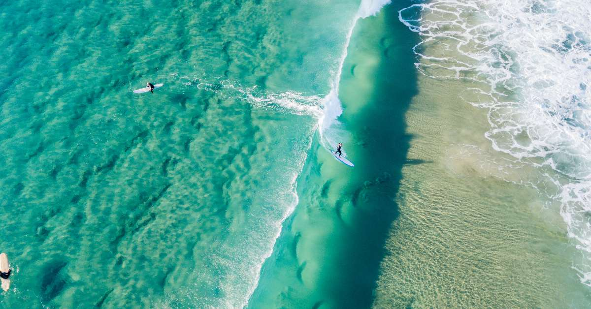 Surfers catching waves at Surfers Paradise GC